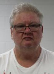 Greg H. Markham, 52, shown in a mugshot.