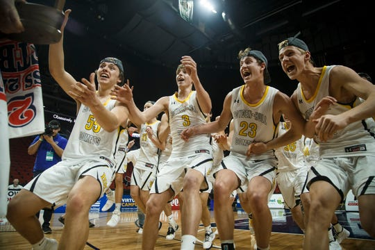 Boyden-Hull grabs their 2A state boys basketball championship game trophy after defeating North Linn 64-51 at Wells Fargo Arena on Friday, March 13, 2020, in Des Moines.
