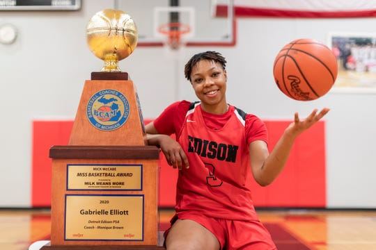Gabrielle Elliott of Detroit Edison, winner of the Miss Basketball award, poses with the trophy at Detroit Edison Public School Academy in Detroit, Friday, March 13, 2020.