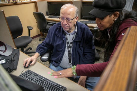 U of D Jesuit faculty member Charles Gumble gets helps from Dean of Instructional Technology Gwendolyn Bush as she helps organize remote educational tools as Coronavirus threats loom Friday, March, 13, 2020.