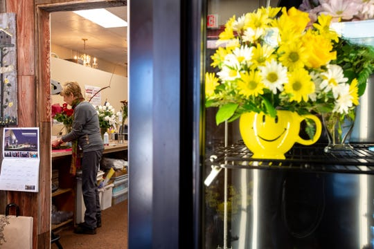 Patricia York works on an arrangement for a customer at Jim's Florist in Warren on Friday, March 13, 2020. The business has lost some revenue due to events being cancelled because of the Corona Virus concerns.