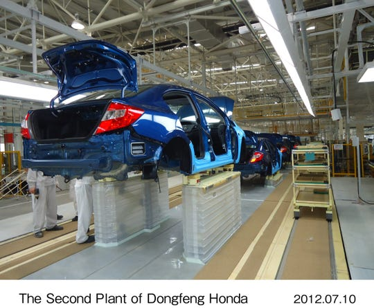 The production line at Honda's joint venture in Wuhan, China, with local automaker Dongfeng Honda Automobile Co. Ltd., which employs 12,000.