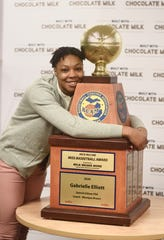 Gabby Elliott hugs her Miss Basketball trophy on Friday at Detroit Edison High School.