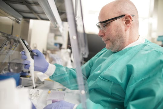 Duane Newton, director of the clinical microbiology laboratory at Michigan Medicine, works on a potential test for the coronavirus. March 2020