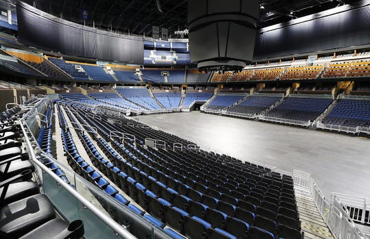 The seats are empty at the Amway Center in Orlando, home of the NBA's Orlando Magic, on Thursday. The NBA has suspended the season due to the coronavirus - as have other sports.