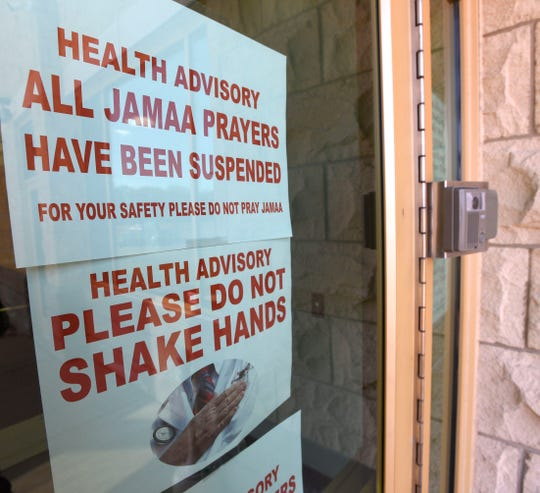 Personal protection instructions are posted on the office doors to the Islamic Center of America Friday afternoon.