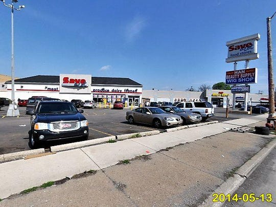 The strip mall is a half-mile north of The Heidelberg Project on Detroit's east side.