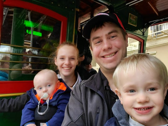 Peter and Monica Radecki, and their sons Peter, 2, and David, 10 months-old, pictured on a January trip to San Francisco, worry they may have contracted coronavirus but are unable to get tested.