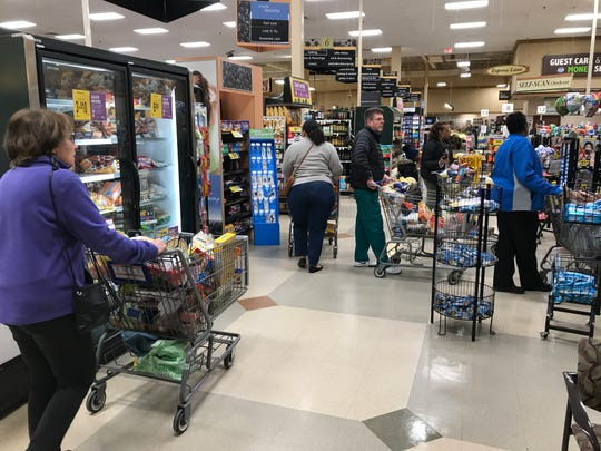 Shoppers at the Kroger grocery store in Grosse Pointe Woods fill their shopping carts on March 12, 2020.