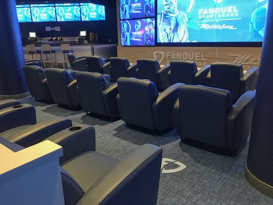The sports book's comfortable chairs sat empty on their second day of service.