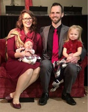 Paul Brown, sitting with his wife, Rebekah, along with their two daughters, is the new pastor at Glen Baptist Church.