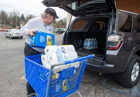 Bob Brown loads his car with recently purchased beer and toilet paper while stocking up due to the threat of the coronavirus at Wesselman's Supermarket on Upper Mount Vernon Rd., Friday afternoon, March 13, 2020.