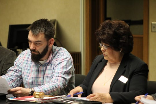 Fremont Auditor Paul Grahl, left, and Fremont City Council member Angie Ruiz look over an ordinance at Thursday's special city council meeting.