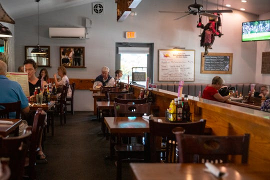 Patrons at Alice Sweetwater's Bar & Grill in North Naples enjoy dinner on Thursday, March 12, 2020.