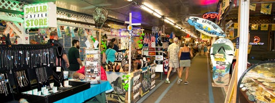 Shoppers stroll along booths at the Fleamasters Fleamarket in Fort Myers.