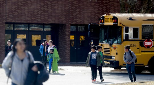 Franklin Middle School students exit the building at the end of the school day on Friday.