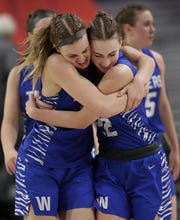 Wrightstown's Ella Diny, left, and Samantha Kiel celebrate after the Tigers defeated Lake Mills during their Division 3 semifinal game at the WIAA girls state basketball tournament Thursday in Ashwaubenon.