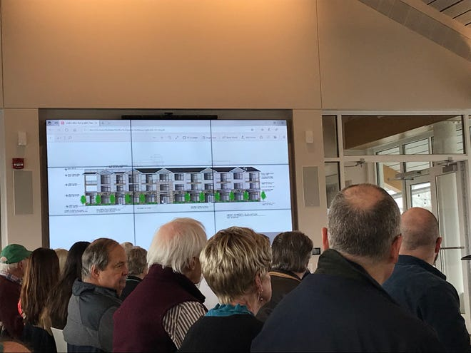 Egg Harbor residents fill the Kress Pavilion Grand Room for a public hearing on The Residences at Egg Harbor, a proposed 27-unit condominium development.