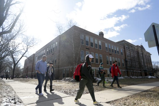 Students leave Aldo Leopold Community School at the end of the school day on Friday.