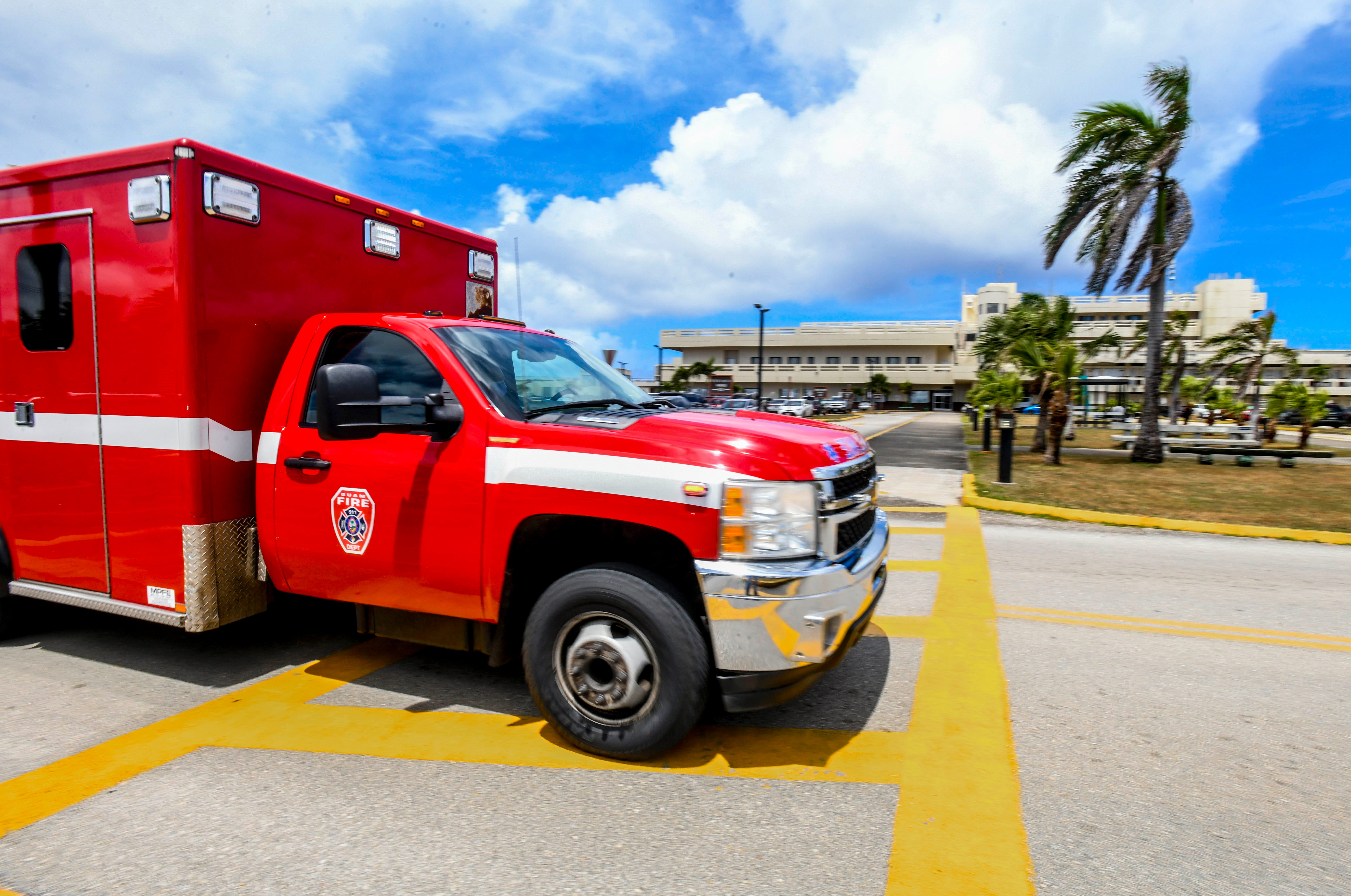 A Guam Fire Department ambulance approaches the Guam Memorial Hospital on Friday, March 13, 2020. The hospital announced it has amended its visitors policy effective Sundayin light of the public health crisis.