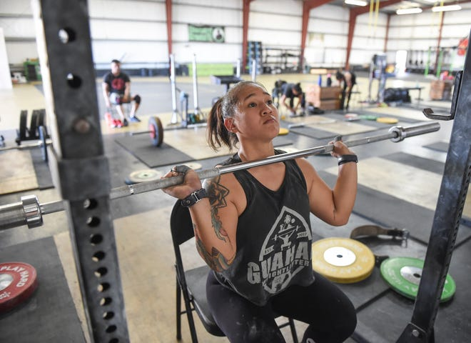Ja Sumagaysay, a Guam weightlifter, works on seated presses at Chamorri Crossfit in Tiyan, March 13, 2020.