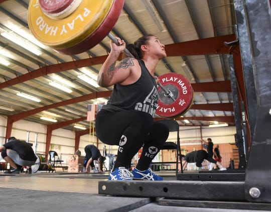 Ja Sumagaysay, a decorated Guam weightlifter, does back squat training at Chamorri Crossfit in Tiyan, March 13, 2020.