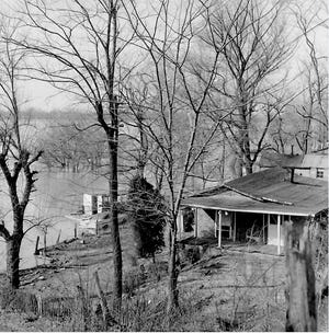 One of the more spacious houses in Fishtown was the Robert and Alice Stone home, shown here during high water in a Gleaner photo taken March 18, 1967. The tiny community under the river bluff, which got its name as a fish market, was a part of local history from Henderson's earliest days until the city of Henderson gradually razed the houses in the early 1990s.