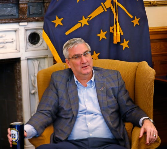 Governor Eric Holcomb speaks to the media in his Indiana Statehouse office about COVID-19, Friday, March 13, 2020. Indiana State Health Commissioner Dr. Kris Box, not pictured, also spoke during the press meeting.
