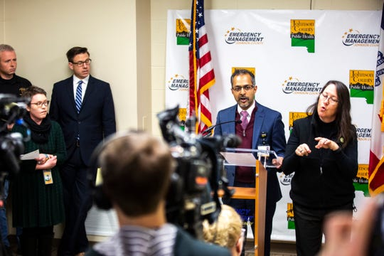 Suresh Gunasekaran, University of Iowa Hospitals and Clinics CEO, speaks during a press conference providing an update on COVID-19 as an American Sign Language interpreter translates, Friday, March 13, 2020, at the Johnson County Emergency Operations Center in Iowa City, Iowa.
