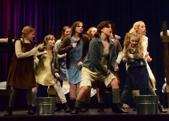 """The orphans at Hudson Street Orphanage, led by Annie, sing """"It's a Hard Knock Life"""" during an """"Annie"""" preview at Night of the Arts, Karns High School, March 10, 2020."""