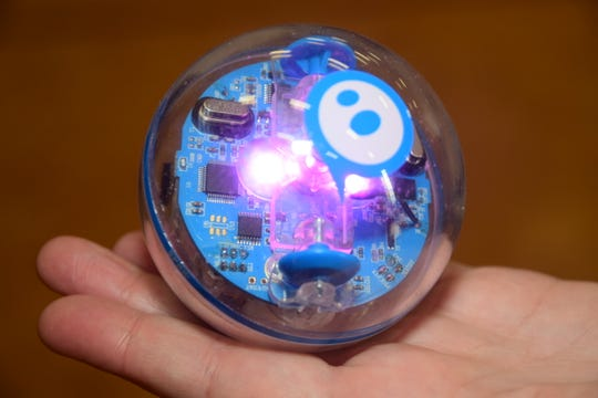 Lighted Sphero Bots programmed to quickly roll across the floor by a smartphone app delighted the kids as the bots chased each other in what seemed like random patterns at Ball Camp Elementary's STEAM Night March 11.