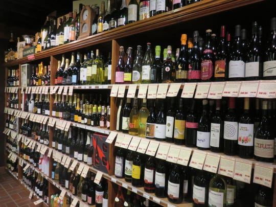 A long wall of shelves features a large variety of wines at Ashe's Wines and Spirits.