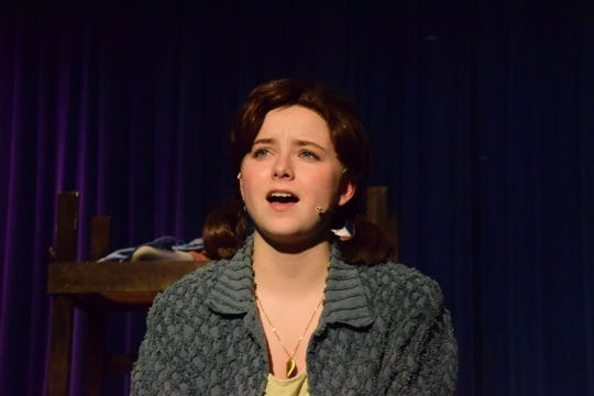 """Annie, played by Madison Senkler, sings """"Maybe"""" during an """"Annie"""" preview at Night of the Arts at Karns High School on March 10, 2020."""