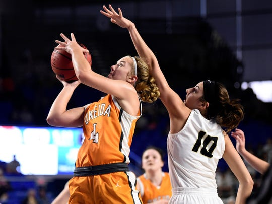 Oneida's Kelsey Pike (4) attempt to score while guarded by Loretto's Victoria Chadwell (10) in the Division 1 Class A girls' basketball quarterfinals on Thursday, March 12, 2020 at Murphy Center in Murfreesboro, Tenn.