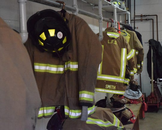Lancaster firefighters' protective gear hangs up, ready to be worn, in Fire Engine House One on March 13. On March 17, Lancaster residents will vote on a levy to increase income tax for the city's safety services.