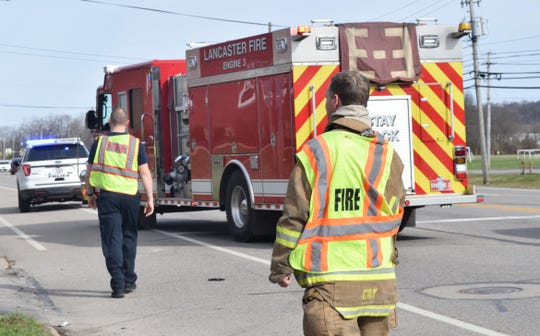Lancaster firefighters prepare to move the fire engine from the street at the scene of a crash on East Main Street in Lancaster March 13. On March 17, Lancaster residents will vote on a levy to increase income tax for the city's safety services.