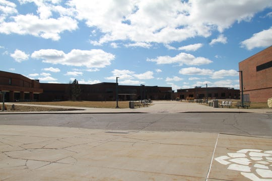 Howell High School's empty courtyard Friday, March 13, 2020, the day all public schools in Livingston County closed due to the coronavirus.
