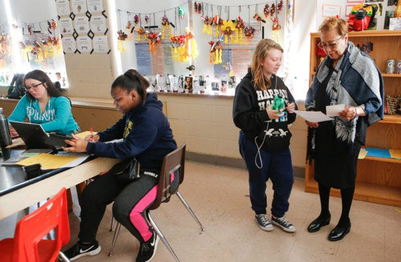 Sharon Porter Robinson, a member of the Kentucky Board of Education, works with students.