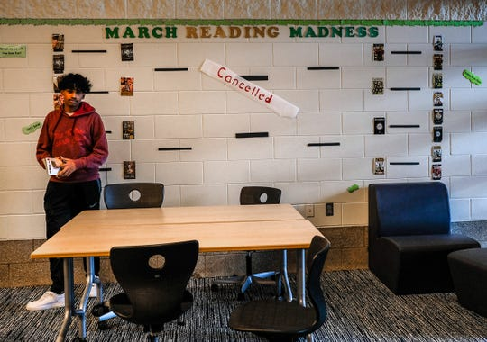"Students at Eastern High School's library are greeted with a ""Cancelled"" sign for March Reading Madness Friday, March 13, 2020 as Michigan Governor Gretchen Whitmer declared all schools to be closed for three weeks beginning Monday."