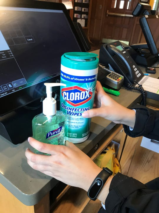 Hand sanitizer and disinfecting wipes provided to staff at the Heritage Commons, Landon Hall's dining room following concerns of the spread of coronavirus.