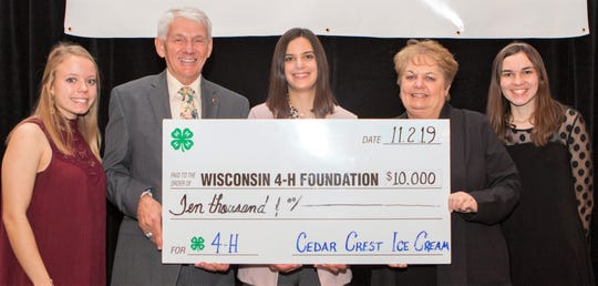 The Wisconsin 4-H Foundation recently recognized partner Cedar Crest Ice Cream as a top 4-H donor. Pictured from left: Holly Adams, Monroe County; Jim Barthel, Wisconsin 4-H Foundation Board president; Kaitlyn Mazza, marketing manager of Cedar Crest; Nancy Bilz, Wisconsin 4-H Foundation Board treasurer; and Taylor Baerwolf, Columbia County.