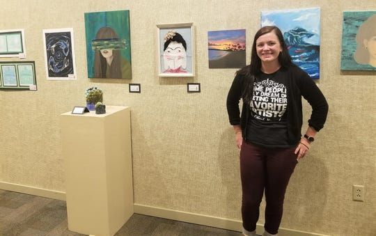 Samantha Deeley with some of her students' artwork at the Youth Art Month exhibition at the Rahr-West Art Museum in Manitowoc.
