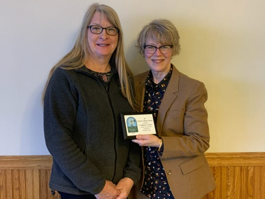 """2019 History Makers Award: Evergleams on Eighth. Barb Bundy-Jost and Cathy Karl accepted the award on behalf of the Evergleams on Eighth """"Gleaming Group."""""""