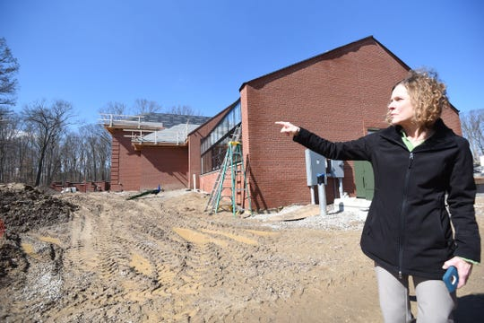 Brenda Nelson gives a tour and points out the progress of construction in the Kingwood expansion project.