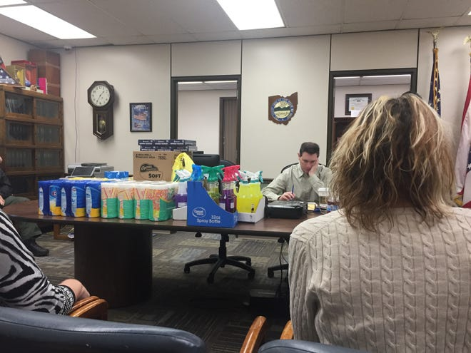 Richland County Commissioner Tony Vero sits by a bevy of cleaning supplies Friday morning. Commissioners met with officeholders to talk about how to react to the coronavirus.