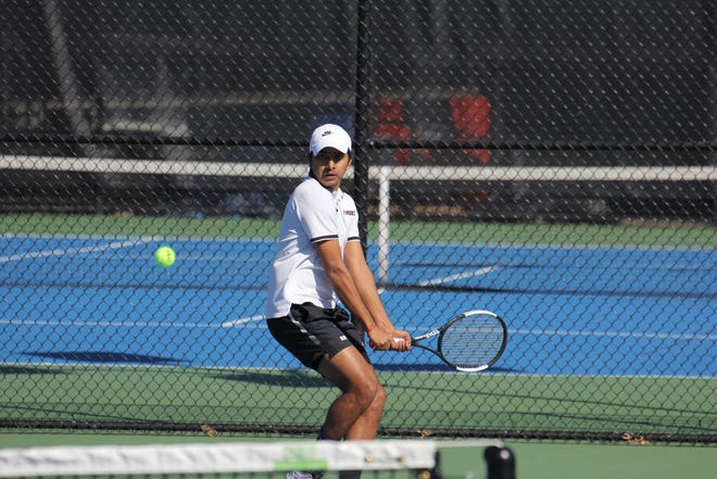 Rhodes senior Ritwik Chatterjee has 66 singles wins and 53 doubles wins for a new program record 119 career combined victories.