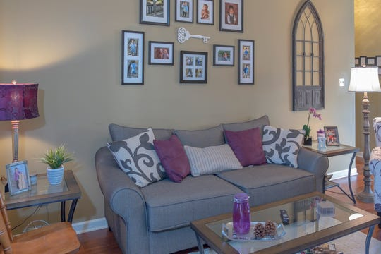 The walls of the living room in Andrea Humphrey's home showcase family photos.