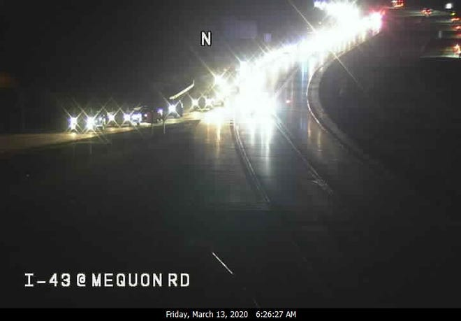 Southbound traffic on Interstate 43 was closed at Mequon Road Friday morning after a car fire.