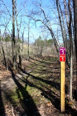 Colored signs guide hikers on the trails at the New Fane trails in the Kettle Moraine State Forest-Northern Unit.