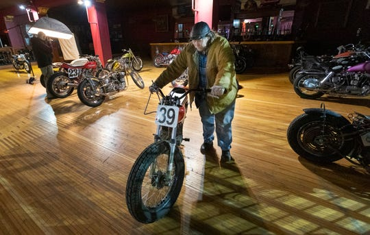 A man removes a motorcycle that was to be shown at the Mama Tried Motorcycle Show at the Eagles Ballroom in Milwaukee. The show, featuring 100 customized motorcycles, was scheduled to run Saturday and Sunday. Also canceled was Fast Out Friday motorcycle races at Fiserv Forum.